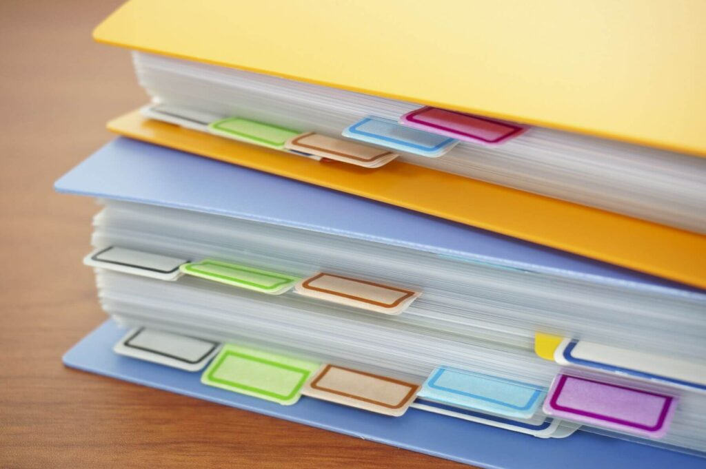 Two binders stacked on top of each other