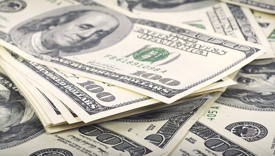 Pile of hundred dollar bills